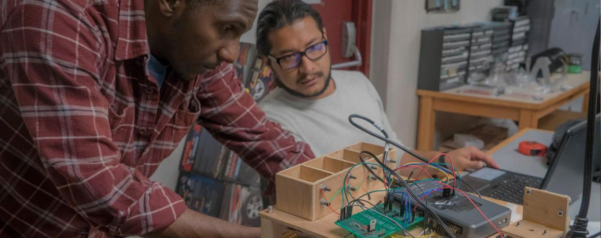 Men connecting up robotics and wires